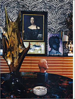 Designer Doug Meyer's Miami house featuring table and coasters by Piero Fornasetti and wall sculpture by Curtis Jere.