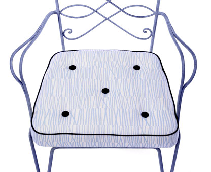 Chair cushion in outdoor fabric designed by Doug & Gene Meyer for Link Outdoor. Pattern is called Matchstick with Carbon canvas piping and buttons.