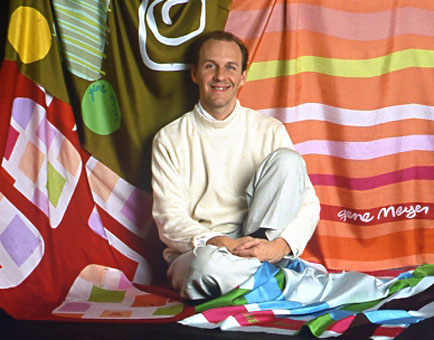 Designer Gene Meyer  Surrounded by his printed silk scarves.  Scarves from the 1991 and 1992 collections.  Photography by Jack Deutsch.