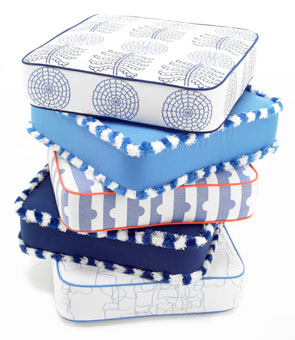 Stack of outdoor cushions with fabrics and trims designed by Doug & Gene Meyer for Link Outdoor.