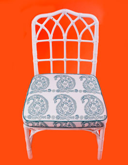 Chair cushion featuring Doug & Gene Meyer designed fabric for Link Outdoor, pattern featured is called Palme.